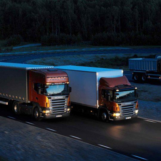 Three-orange-Scania-trucks-540x540.jpg