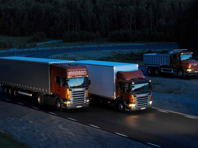 Three-orange-Scania-trucks-640x480.jpg