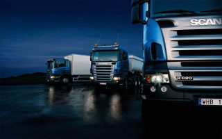 Three-trucks-on-blue-background-320x200.jpg